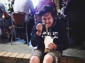 Thomas eating asian noodles