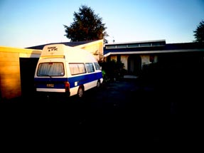 our van in front of Chris house