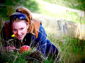 Bianca is hiding behind a fly agaric
