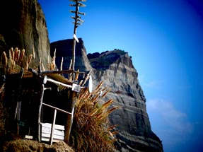 Wooden shed on the rocks