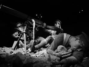 Larger than life figures War scene