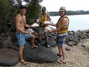 3 fishermen with fish