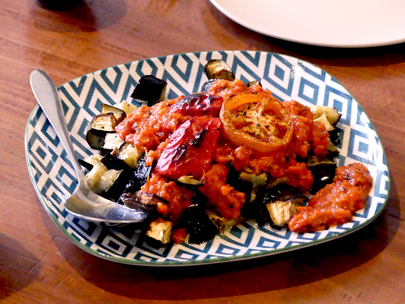 Balkans Roasted eggplant with tomato-capsicum sauce
